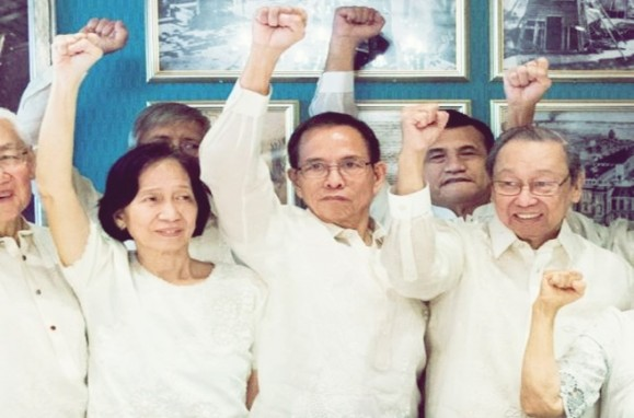 Communist Party of the Philippines'  Benito Tiamzon (C) and his wife Wilma Austria Tiamzon (L) gesture next to Jose Maria Sison, the exiled founder of the Communist Party, in Oslo