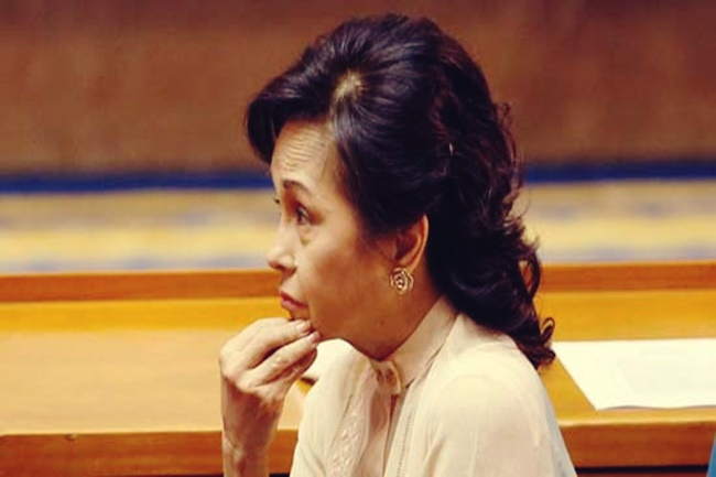 Former President and Congresswoman Gloria Macapagal Arroyo, who was released from hospital arrest a few days ago, listens during the opening of the Philippine Congress in Quezon