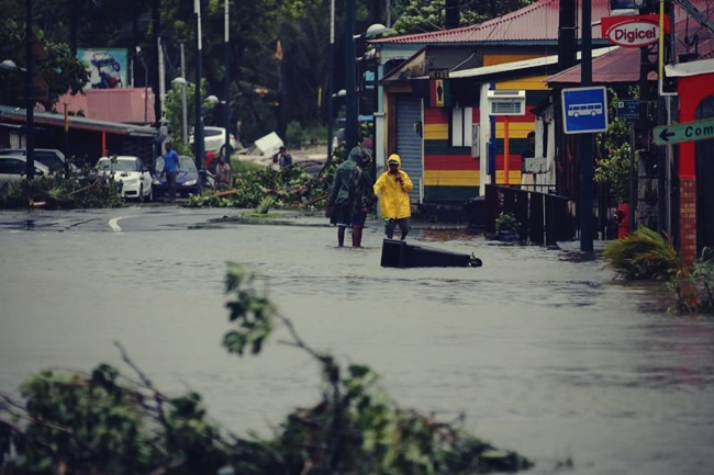 People walk in a flooded street after the passage of Hurricane Maria in Pointe-a-Pitre, Guadeloupe island