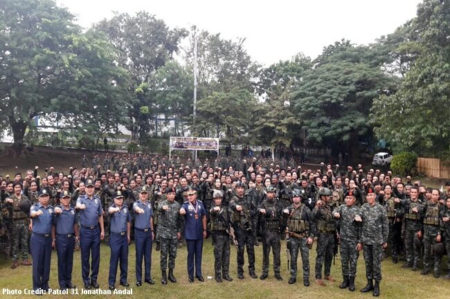 176 SAF Marawi contingent, their commanders, PNP Chief Dela Rosa do Duterte fist after the Heroes Welcome ceremony in Taguig