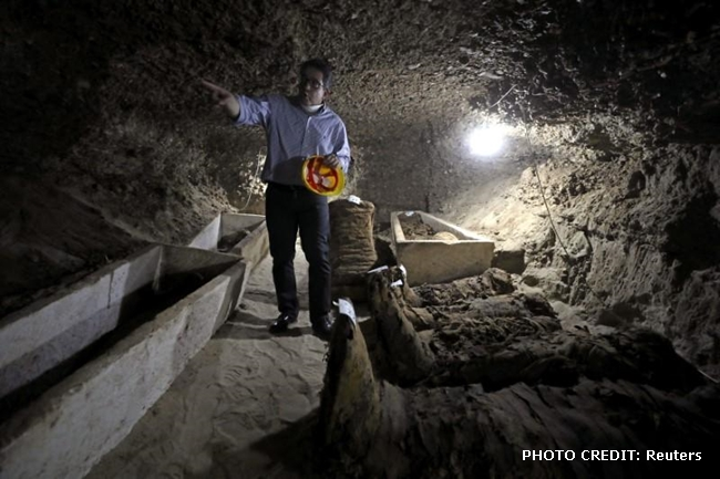 Egyptian Minister of Antiquities Khaled Al-Anani inside a newly discovered burial site in Minya